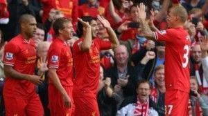 Luis Suarez celebra uno de sus goles.