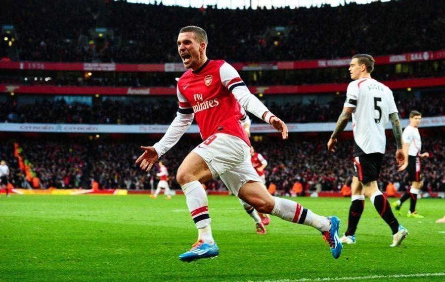 Lukas Podolski of Arsenal celebrates scoring to make it 2-0