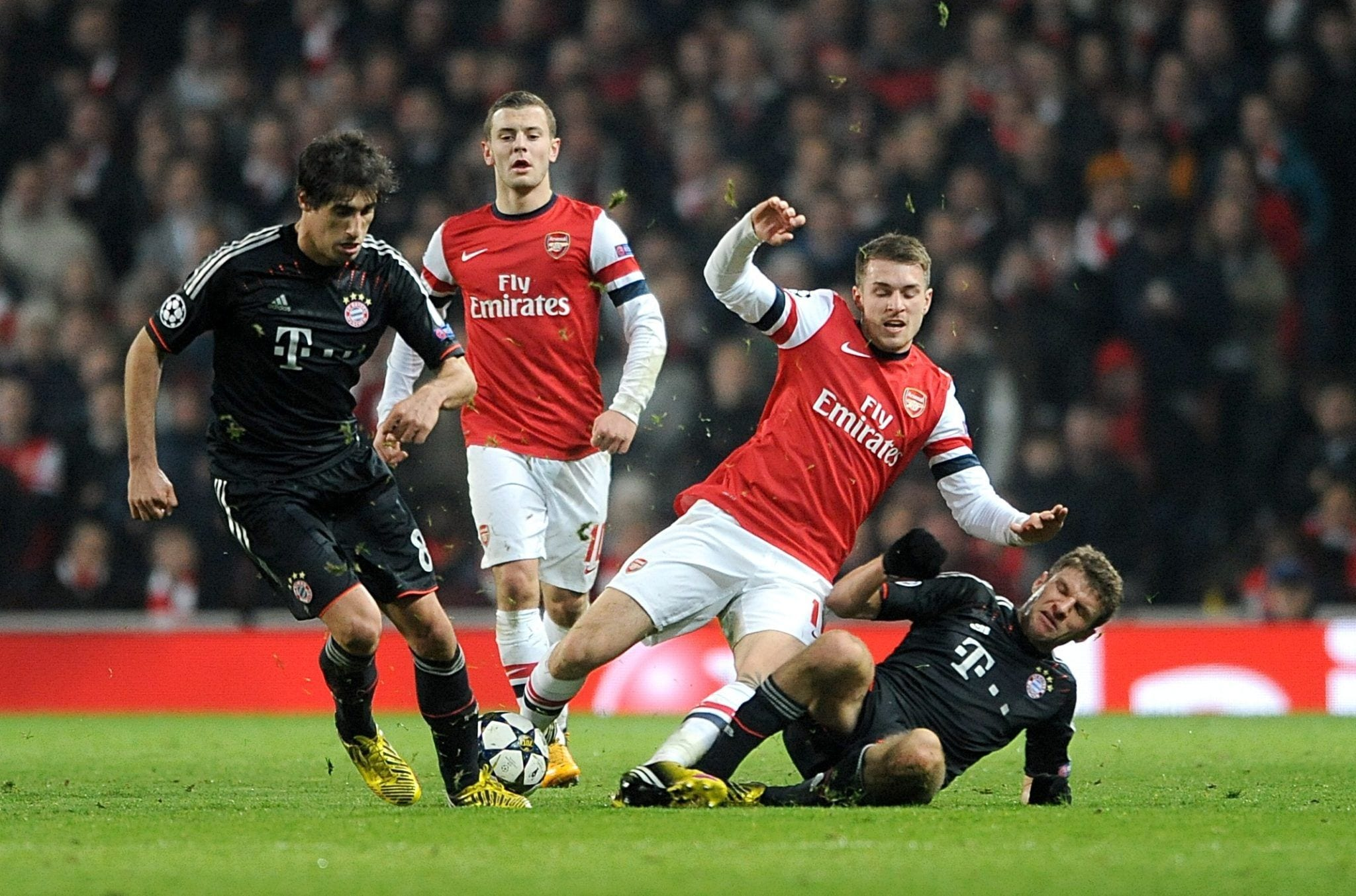 Bayern Munich's Thomas Muller (right) and Arsenal's Aaron Ramsey battle for the ball during the UEFA Champions League match at Emirates Stadium, London. PRESS ASSOCIATION Photo. Picture date: Tuesday February 19, 2013. See PA story SOCCER Arsenal. Photo credit should read: Anthony Devlin/PA Wire