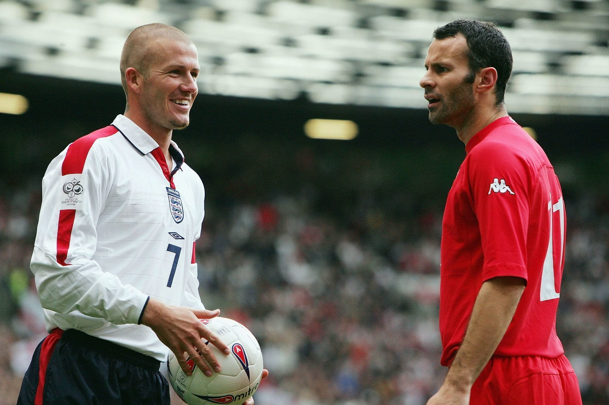 MANCHESTER, ENGLAND - OCTOBER 9:  David Beckham of England and Ryan Giggs of Wales share an exchange during the 2006 World Cup Qualifying match between England and Wales at Old Trafford, on October 9, 2004 in Manchester, England.  (Photo by Laurence Griffiths/Getty Images)