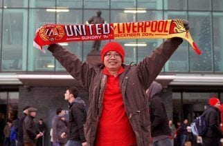 MANCHESTER, ENGLAND - Sunday, December 14, 2014: A Manchester United supporter with a half and half scarf before the Premier League match at against Liverpool Old Trafford. (Pic by David Rawcliffe/Propaganda)
